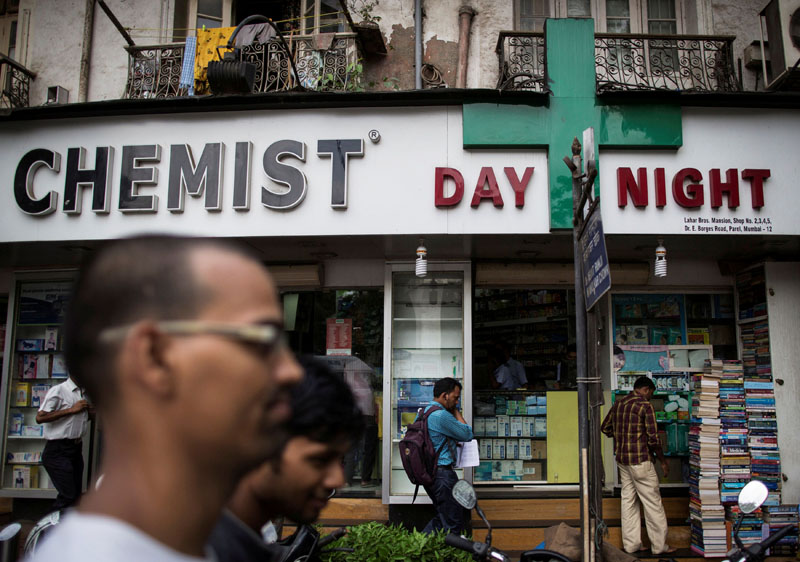 People walk past a chemist shop at a market in Mumbai, India, June 24, 2014. Photo: Reuters/File