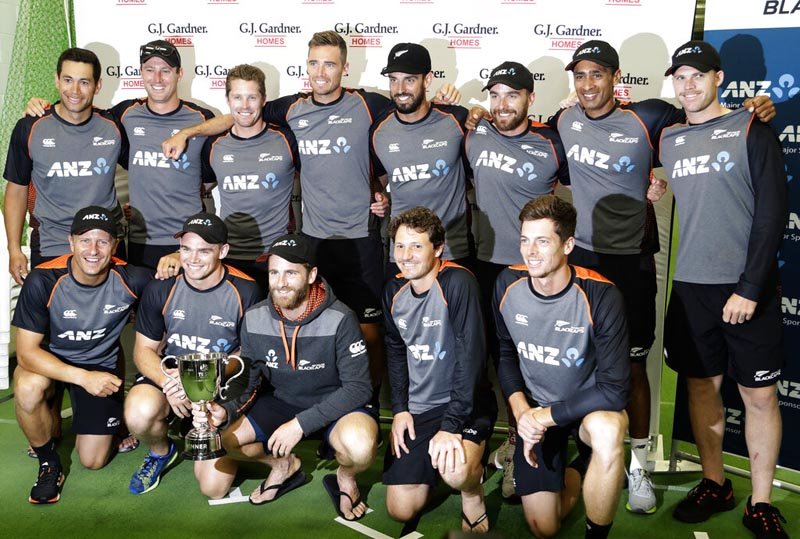 New Zealand players pose for a team photo with the trophy following play on the final day of the second cricket test between England and New Zealand at Seddon Park in Hamilton, New Zealand, Tuesday, December 3, 2019. Photo: AP