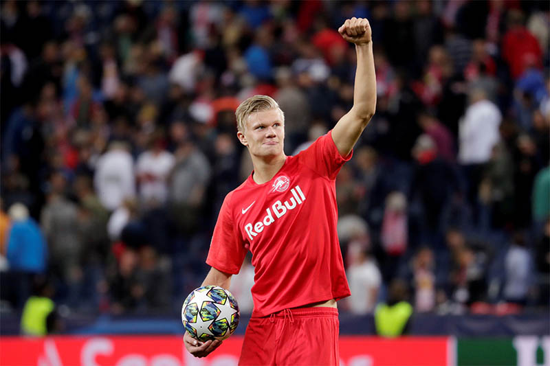 FILE: RB Salzburg's Erling Braut Haaland celebrates winning the match and scoring a hat-trick with the match ball. Photo: Reuters