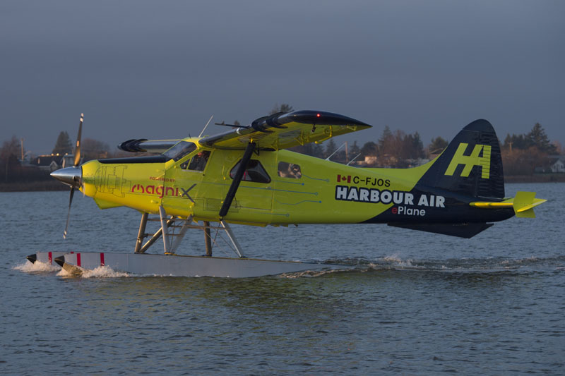 The world's first electric commercial aircraft owned and operated by Harbour Air is seen during its maiden flight in Richmond, British Columbia, Tuesday, Dec 10, 2019. Photo: Jonathan Hayward/The Canadian Press via AP