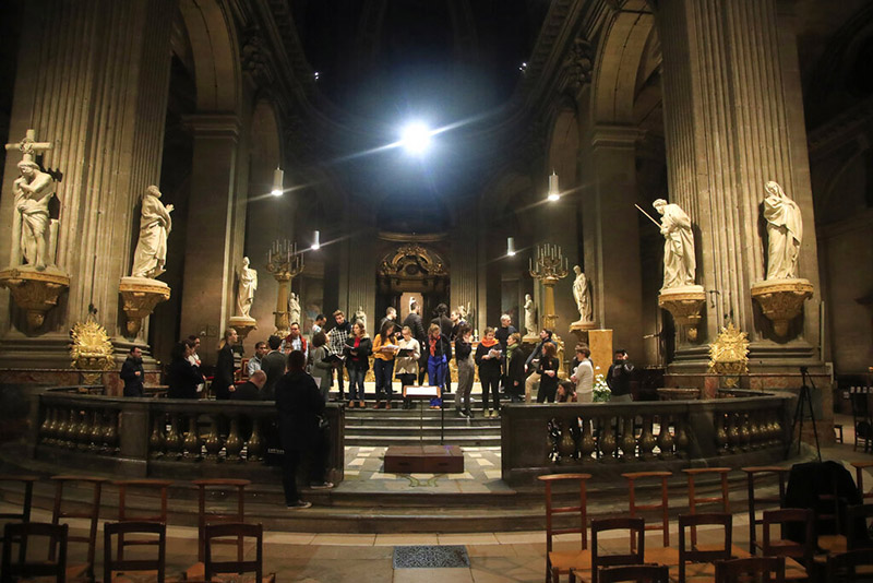 In this photo taken Monday, December 16, 2019, members of the Notre Dame cathedral choir rehearse at the Saint Sulpice church in Paris. Notre Dame Cathedral kept holding services during two world wars as a beacon of hope amid bloodshed and fear. It took a fire in peacetime to finally stop Notre Dame from celebrating Christmas Mass for the first time in more than two centuries. Photo: AP