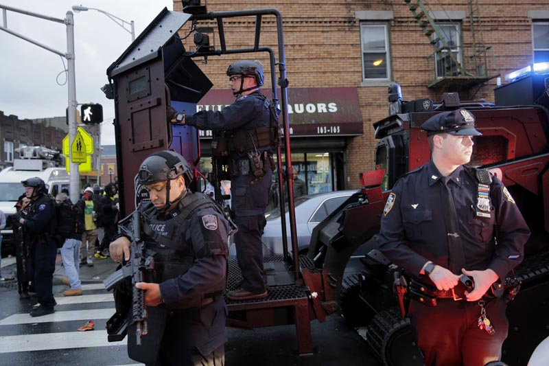 Emergency responders move heavy equipment near the scene of a shooting in Jersey City, N.J., Tuesday, Dec. 10, 2019. Photo: AP