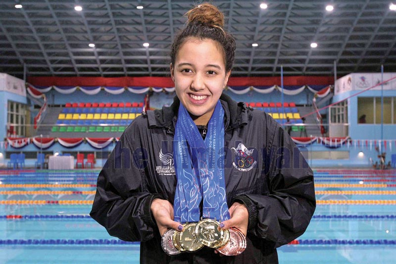 Swimmer Gaurika Singh displays her nine medals after medal ceremony of the 13th South Asain Games at International Sports Complex Swimming Pool, Satdobato in Lalitpur on Monday, December 9, 2019. Photo: Udipt Singh Chhetry/THT