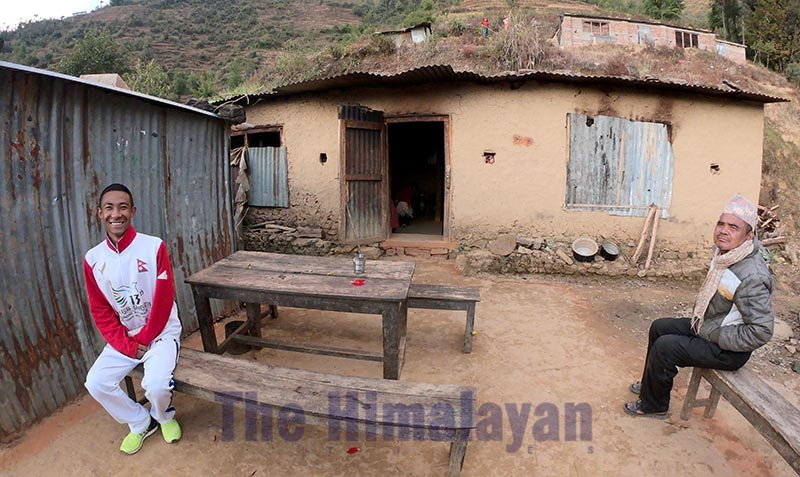 Golfer Subash Tamang sits in front of his house, on Tuesday, December 17, 2019. Photo: THT