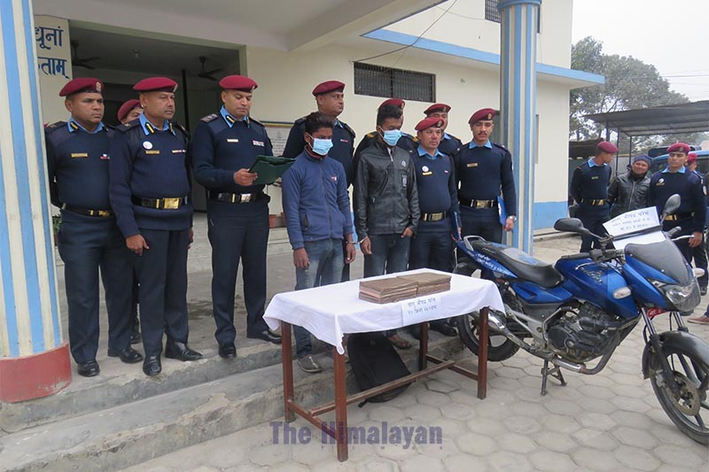 Police make public two persons arrested in possession of hashish, and parade impounded motorcycle, at Makawanpur District Police Office, in Hetauda, Makawanpur district, on Friday, December 13, 2019. Photo: Prakash Dahal/THT