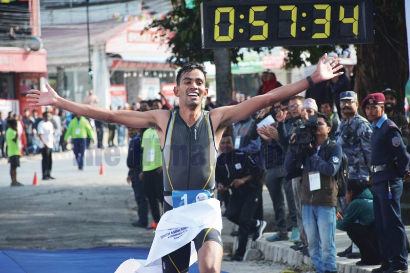 Himal Tamata celebrates after winning gold medal in duathlon under the 13th South Asian Games in Pokhara on Tuesday, December 3, 2019. Photo: THT