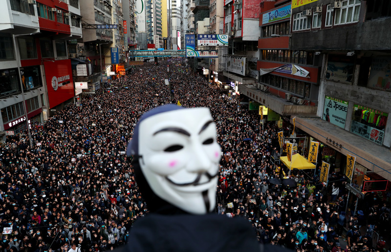 A protester wearing a Guy Fawkes mask attends a Human Rights Day march, organised by the Civil Human Right Front, in Hong Kong, China December 8, 2019. Photo: Reuters