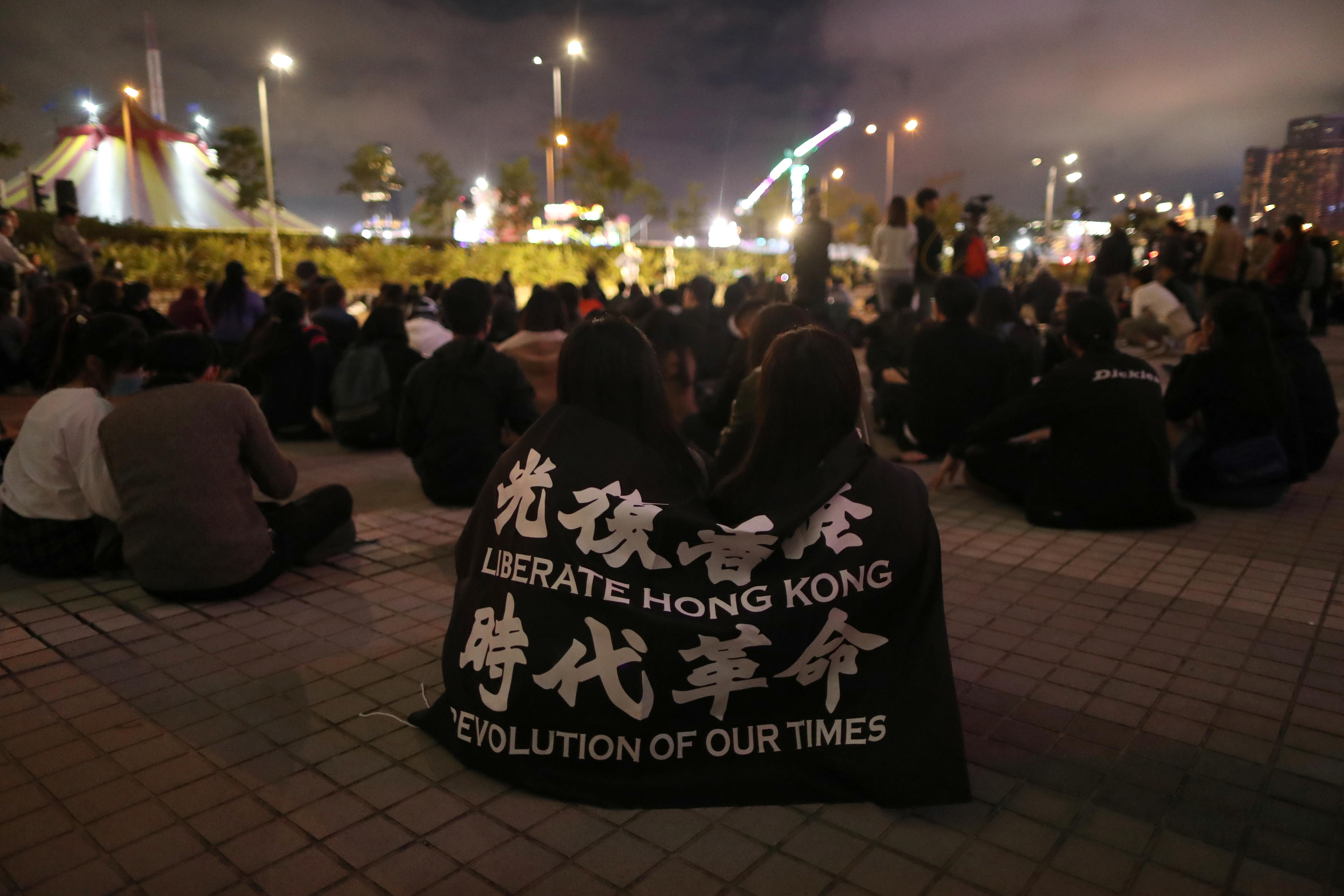 Protesters rally to remember the deaths and injuries during the months of protests, in Edinburgh Place in Hong Kong, China, December 30, 2019. Photo: Reuters