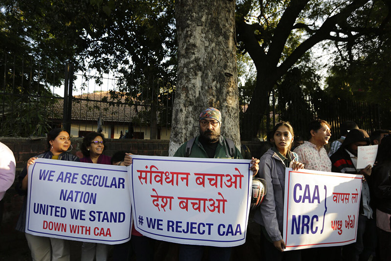 Indians hold placards during a protest against a new citizenship law outside Gandhi Ashram in Ahmedabad, India, Tuesday, December 17, 2019. Indian student protests that turned into violent clashes with police galvanised opposition nationwide on Tuesday to a new law that provides a path to citizenship for non-Muslim migrants who entered the country illegally from several neighbouring countries. Photo: AP