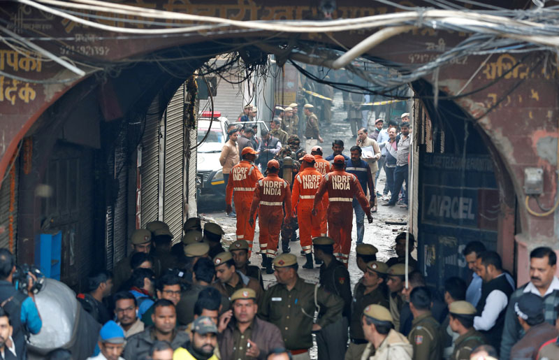 Members of India's National Disaster Response Force (NDRF) head towards the site of a fire that swept through a factory where laborers were sleeping, in New Delhi, India December 8, 2019. Photo: Reuters