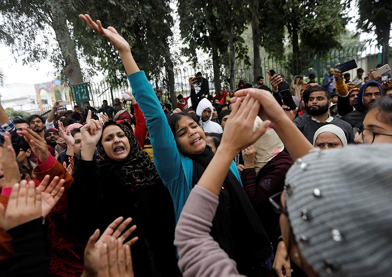Demonstrators shout slogans during a protest against a new citizenship law, outside Jamia Millia Islamia university in New Delhi, India, on December 16, 2019. Photo: Reuters
