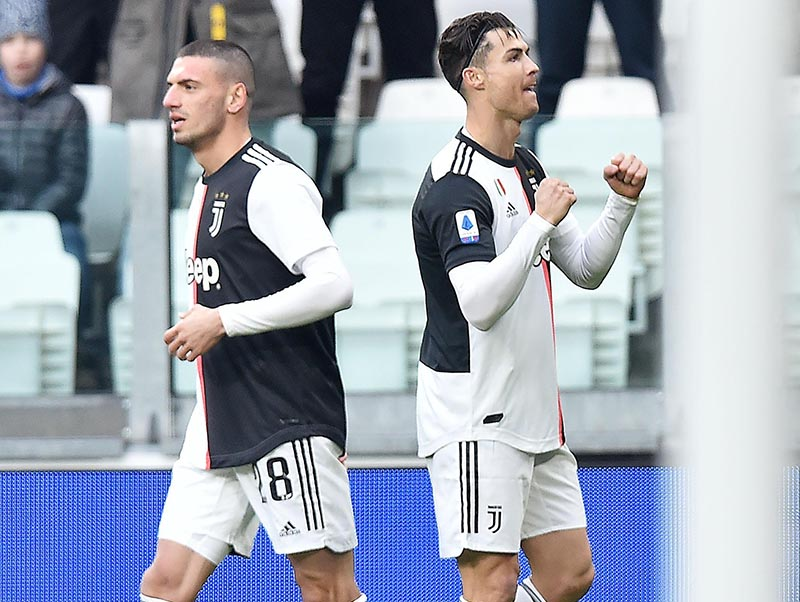 Juventus' Cristiano Ronaldo (right) celebrates after scoring a goal during the Italian Serie A soccer match between Juventus and Udinese at the Allianz Stadium in Turin, Italy, on Sunday, December 15, 2019. Photo: Alessandro Di Marco/ANSA via AP)