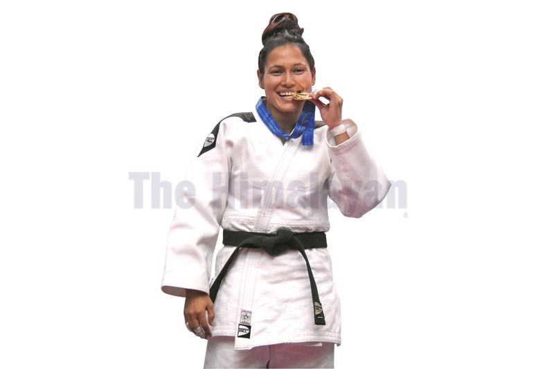 Judoka Devika Khadka celebrates after winning gold medal in the 13th SA Games in Lalitpur on Sunday, December 9, 2019. Photo: NARESH KRISHNA SHRESTHA/THT