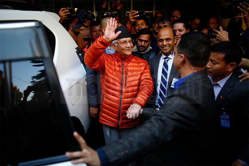 Prime Minister KP Sharma Oli gestures after being discharged from the Tribhuwan University Teaching Hospital, in Kathmandu, on Thursday, December 05, 2019. Photo: Skanda Gautam/THT