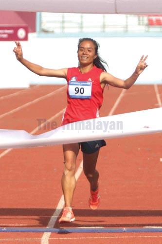 Kanchhi Maya Koju of Nepal APF Club celebrates after winning the 13th Kathmandu Marathon at the Dasharath Stadium in Kathmandu on Saturday, December 21, 2019. Photo: Udipt Singh Chhetry/THT