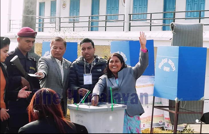 Candidate Bidhya Bhattarai Adhikari from the ruling Nepal Communist Party (NCP) casting ballot at Shanti Udaya Secondary School voting centre in Pokhara, Kaski,u00a0 on Saturday.u00a0 She had filed her candidacy for the parliamentary member from Kaski-2. Photo: THT