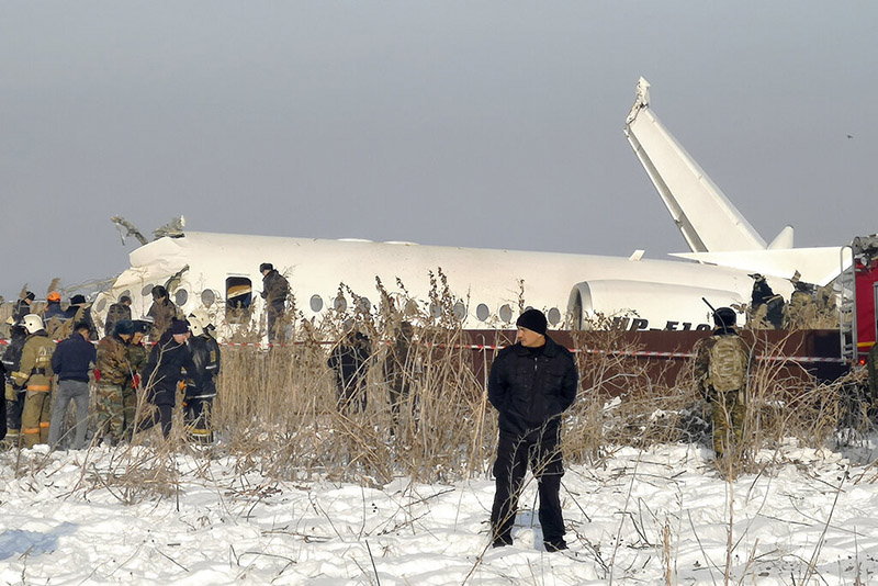 Police guard as rescuers work on the side of a plane crashed near Almaty International Airport, outside Almaty, Kazakhstan, Friday, December 27, 2019. The Kazakhstan plane with 100 people aboard crashed shortly after takeoff early Friday. Photo: AP Photo