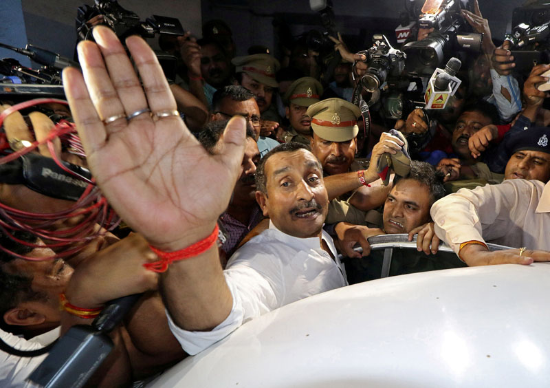 Kuldeep Singh Sengar, a legislator of Uttar Pradesh state from India's ruling Bharatiya Janata Party (BJP), reacts as he leaves a court after he was arrested on Friday in connection with the rape of a teenager, in Lucknow, India, April 14, 2018. Photo: Reuters/File