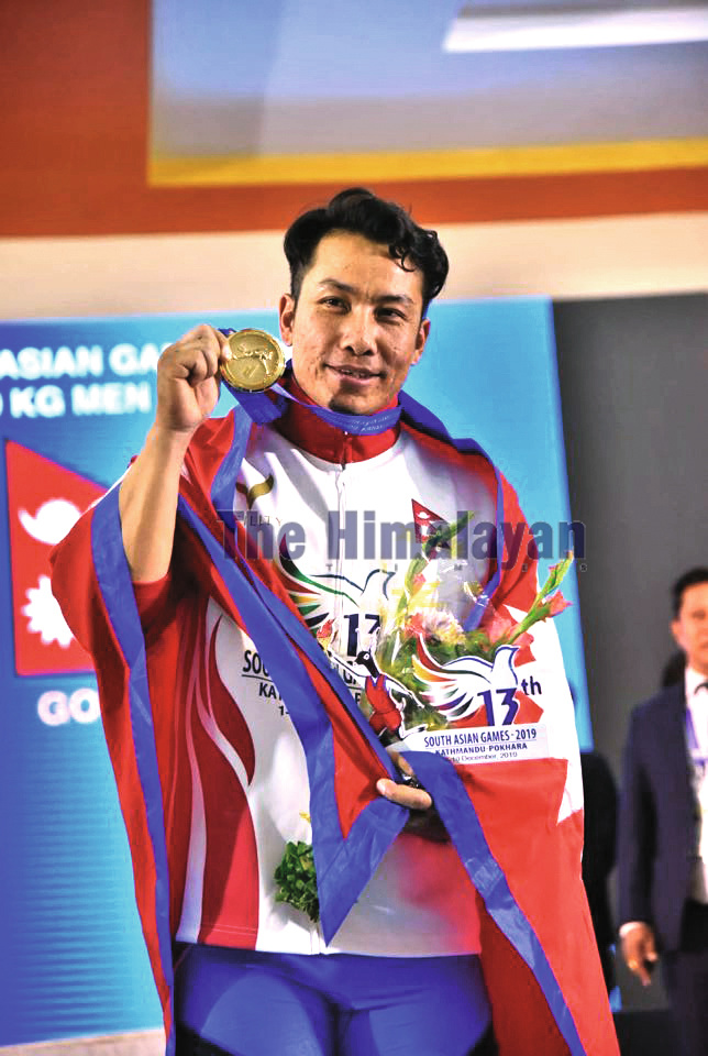 Lifter Bikash Thapa celebrates after winning gold medal in Pokhara, on Friday. Photo: THT