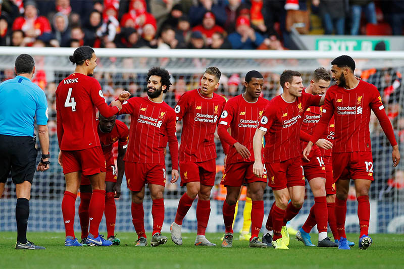 Liverpool's Mohamed Salah celebrates scoring their first goal with teammates. Photo: Reuters