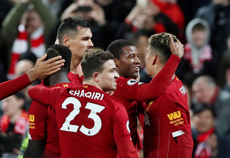 Liverpool's Georginio Wijnaldum celebrates scoring their fifth goal with teammates during the Premier League match between Liverpool and Everton, at Anfield, in Liverpool, Britain, on December 4, 2019. Photo: Reuters