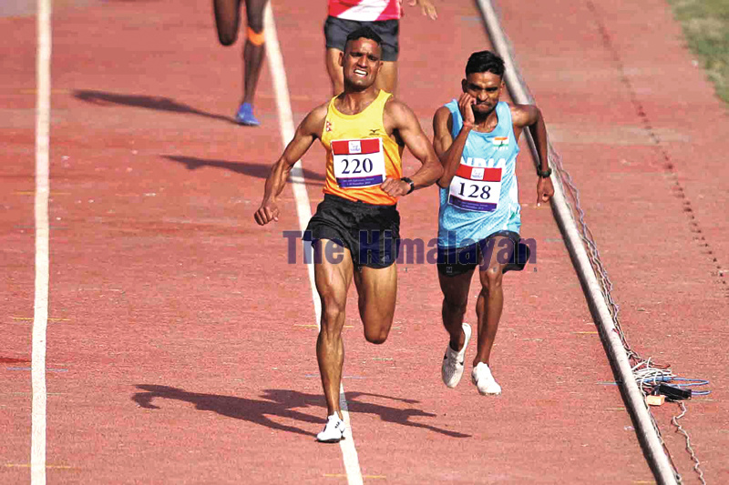 Gopi Chandra Parki approaches at finish line in men's 5000 metres race during the 13th South Asian Games at Dasharath Stadium in Kathmandu on Friday. Photo: Udipt Singh Chhetry/THT