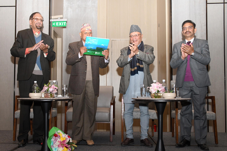 Former president Ram Baran Yadav launching former finance minister Ram Sharan Mahatu2019s book at a function held in Kathmandu, on Wednesday. Photo: THT