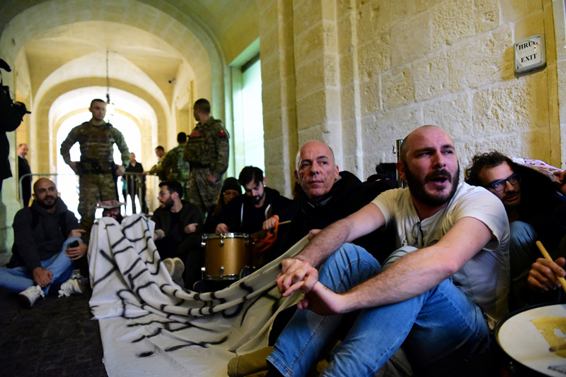 Activists sit after having barged into the building of Malta's Prime Minister Joseph Muscat's office, demanding his resignation in the wake of developments in case of the 2017 murder of anti-corruption journalist Daphne Caruana Galizia, in Valletta, Malta, December 9, 2019. Photo: Reuters