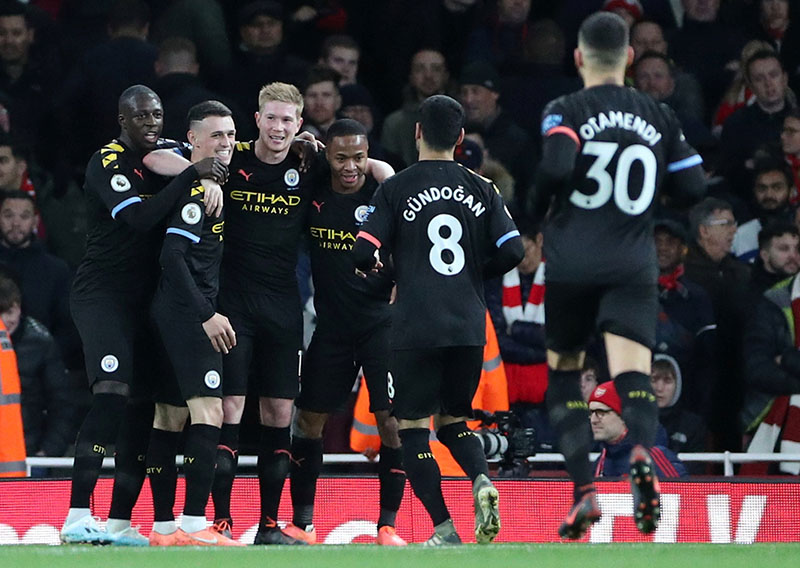 Manchester City's Kevin De Bruyne celebrates scoring their third goal with teammates during the Premier League match between Arsenal and Manchester City, at Emirates Stadium, in London, Britain, on December 15, 2019. Photo: Reuters