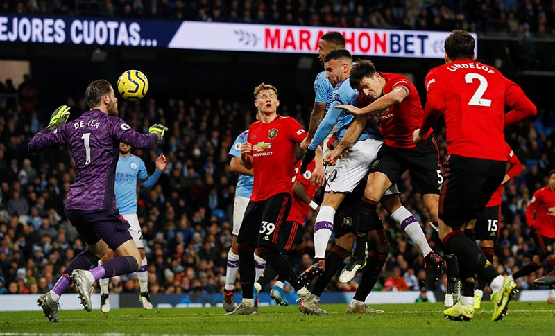 Manchester City's Nicolas Otamendi scores their first goal during the Premier League match between Manchester City and Manchester United, at Etihad Stadium, in Manchester, Britain, on December 7, 2019. Photo: Reuters