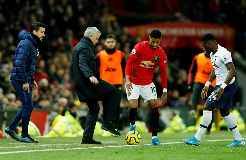 Manchester United's Marcus Rashford, Tottenham Hotspur manager Jose Mourinho and Tottenham Hotspur's Serge Aurier during the match during the Premier League match between Manchester United and Tottenham Hotspur, at Old Trafford, in Manchester, Britain, on December 4, 2019. Photo: Reuters
