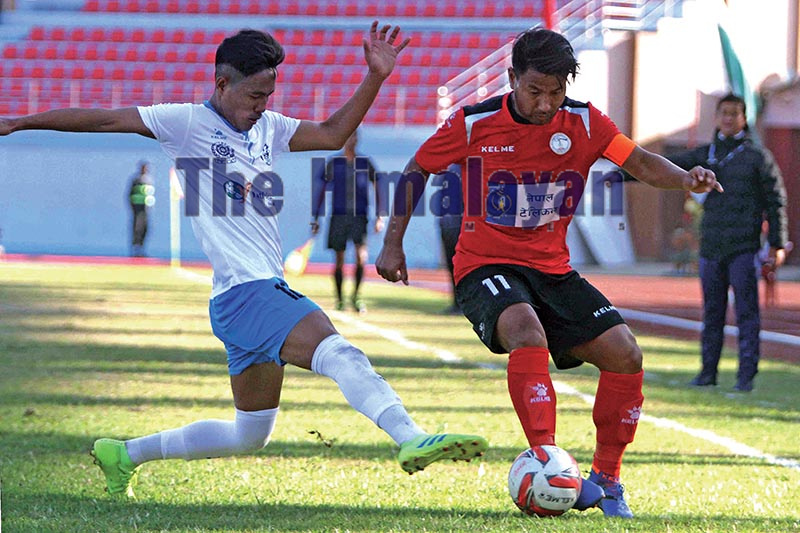 NPC skipper Jumanu Rai (right) and Yeti Himalayan Sherpa Club's Binod Gurung vie for the ball during their Martyrs Memorial 'A' Division League match in Kathmandu on Tuesday. Photo: Udipt Singh Chhetry / THT