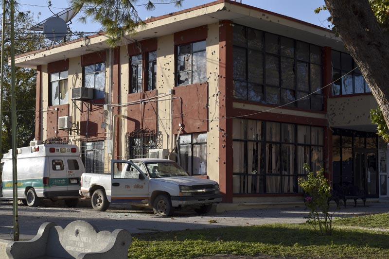 The City Hall of Villa Union is riddled with bullet holes after a gun battle between Mexican security forces and suspected cartel gunmen, Saturday, November 30, 2019. Photo: AP