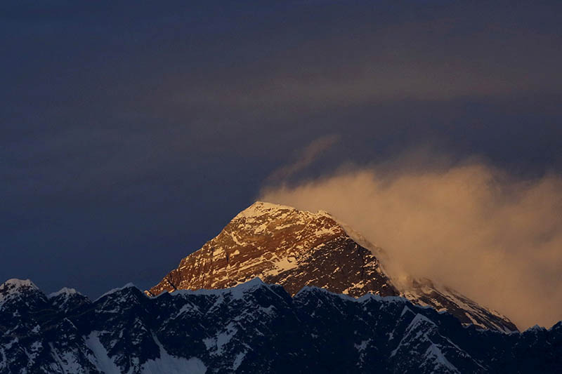 FILE PHOTO: Light illuminates Mount Everest, during the in Solukhumbu District also known as the Everest region, in this picture taken November 30, 2015. Photo: Reuters