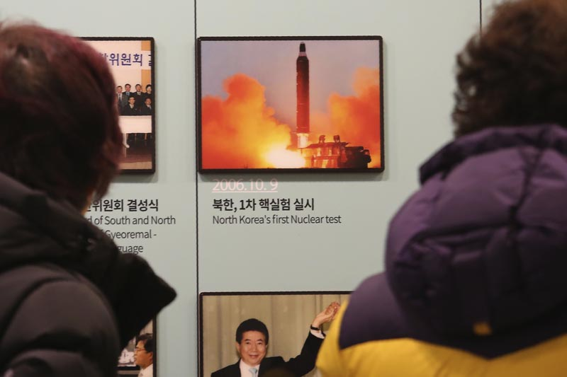 Visitors watch a photo showing North Korea's missile launch at the Unification Observation Post in Paju, South Korea, near the border with North Korea, Friday, December 13, 2019. Photo: AP
