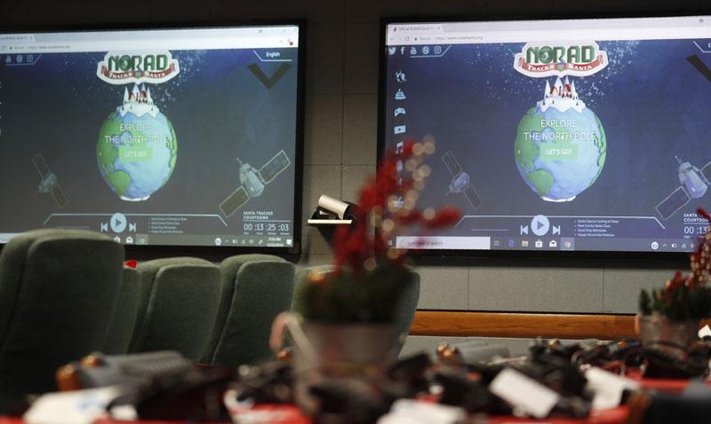 Monitors are illuminated in the NORAD Tracks Santa center at Peterson Air Force Base, Monday, Dec 23, 2019, in Colorado Springs, Colorado. Photo: AP