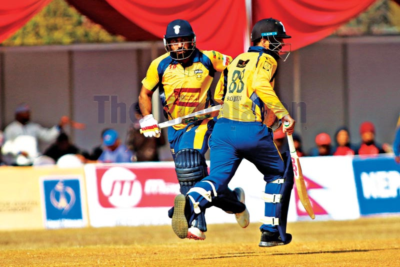 Rohan Mustafa and Babar Hayat (left) of Chitwan Rhinos running between the wickets during their Namaste Pokhara Premier League match against Kathmandu Golden Warriors at the Pokhara Stadium in Kaski on Tuesday, December 24, 2019. Photo: THT