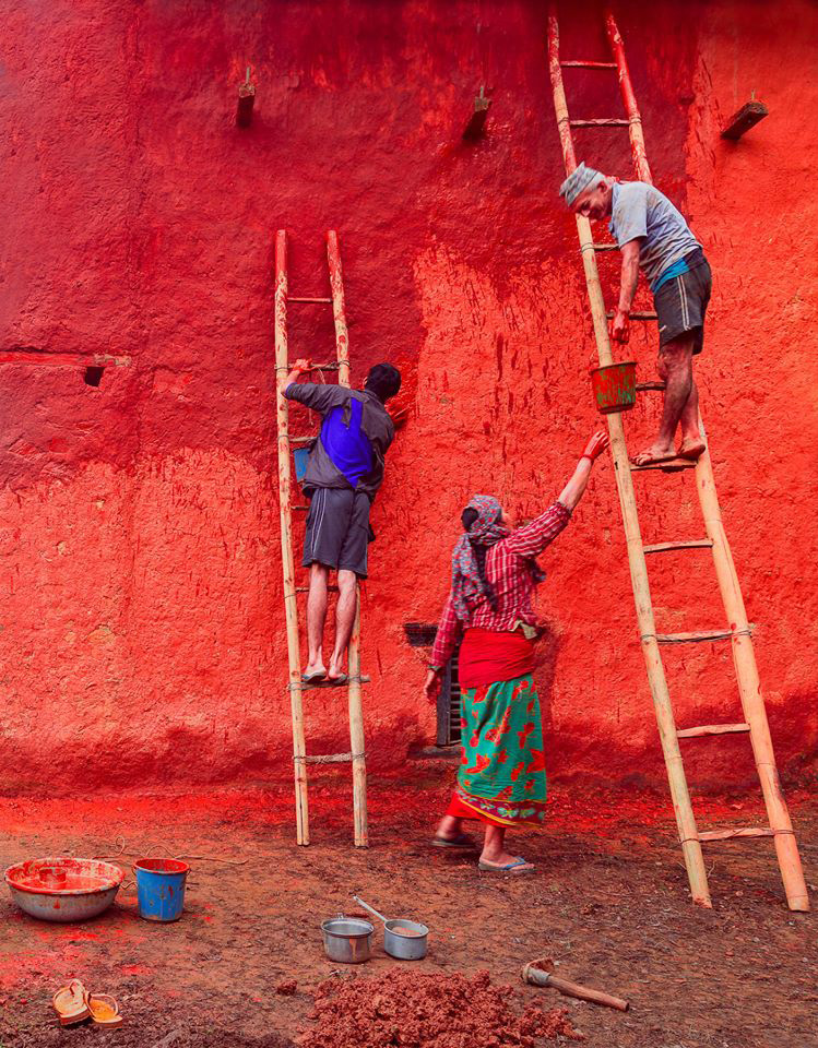 The photograph taken by Mithun Kunwar, winner of the photo competition, displays people painting a house ahead of Dashain in Palpa. Photo Courtesy: Nepal Academy of Fine Arts
