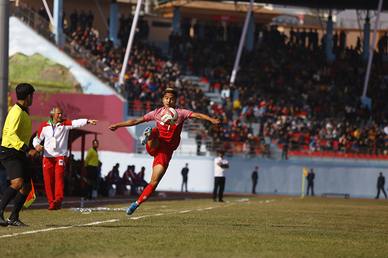 A Nepali team player chases the ball during the football match between Nepal and the Maldives, under the 13th South Asian Games (SAG), at Dashrath Stadium, in Kathmandu, on Saturday, December 7, 2019. Photo: RSS