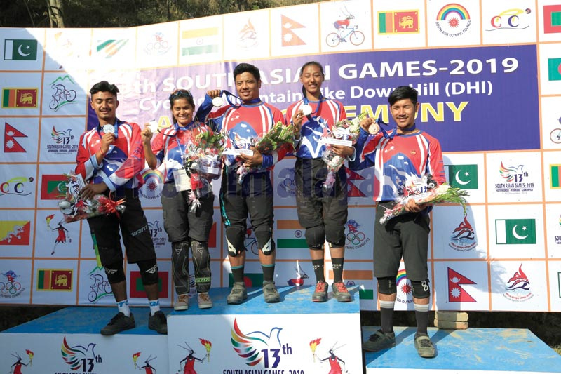 Nepalu2019s cyclists celebrate after winning medals during the ongoing 13th South Asian Games on Wednesday, December 4, 2019. Photo: Udipt Singh Chhetry / THT