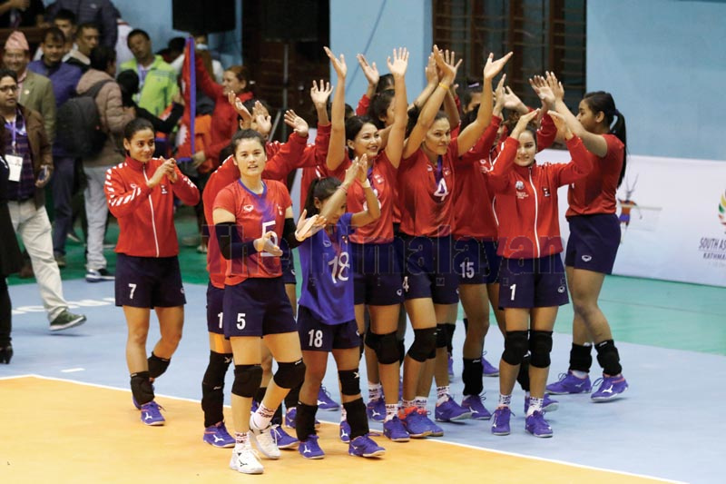 Nepal players celebrate after winning the semi-final match against Sri Lanka in the womenu2019s volleyball tournament under the 13th South Asian Games at the National Sports Council covered hall in Kathmandu on Saturday, November 30, 2019. Photo: Udipt Singh Chhetry / THT