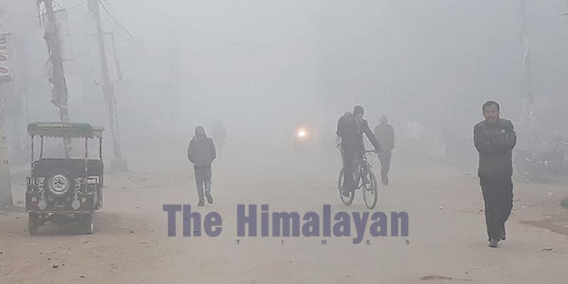 Locals heading towards their destinations through the thick fog caused by the cold wave sweeping across the Tarai, in Nepalgunj, Banke, on Sunday, December 22, 2019. Photo: THT/File