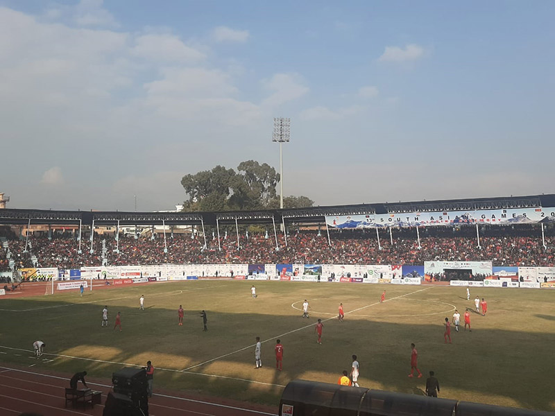 Nepali and Bhutanese players in action during the 13th South Asian Games (SAG)  men's football final, at Dashrath Stadium, in Kathmandu, on Tuesday, December 10, 2019. Photo: Nishant Pokhrel/THT