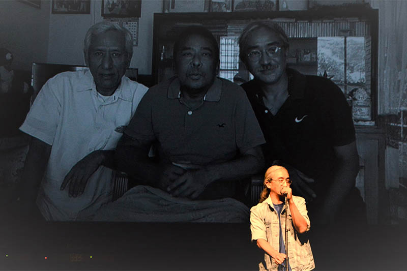 Nepathya frontman Amrit Gurung pays tribute to musician Suk Gurung (middle) during Melbourne concert. Courtesy: Nepalaya