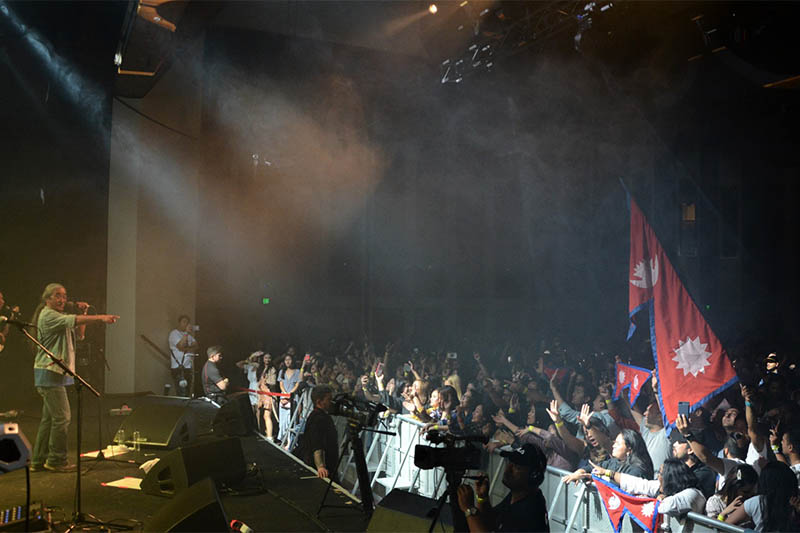 Nepathya's lead singer Amrit Gurung points to the crowd as he performs during the live concert in Hobert, Australia, on Sunday, December 08, 2019. Courtesy: Trijan Bajracharya