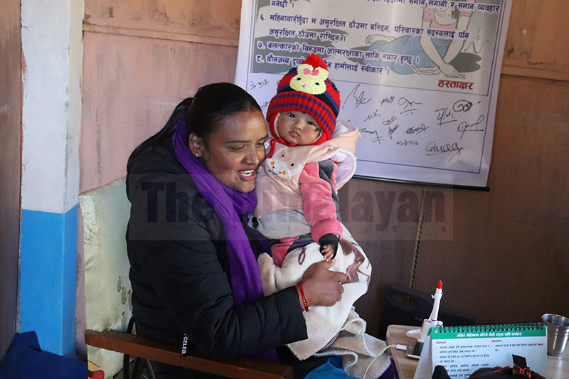Bindu Badaal, a public service provider, is pictured here with her five-month daughter, in Badimalika Municipality, of Bajura district, on Thursday, December 26, 2019. Photo: Prakash Singh/THT