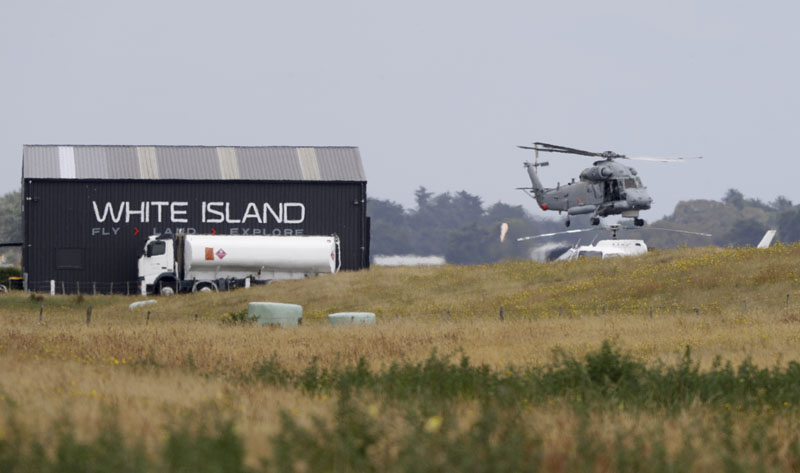 A Navy helicopter hovers at Whakatane Airport, as the recovery operation to return the victims of the Dec 9 volcano eruption continues off the coast of Whakatane New Zealand, Friday, Dec 13, 2019. Photo: AP
