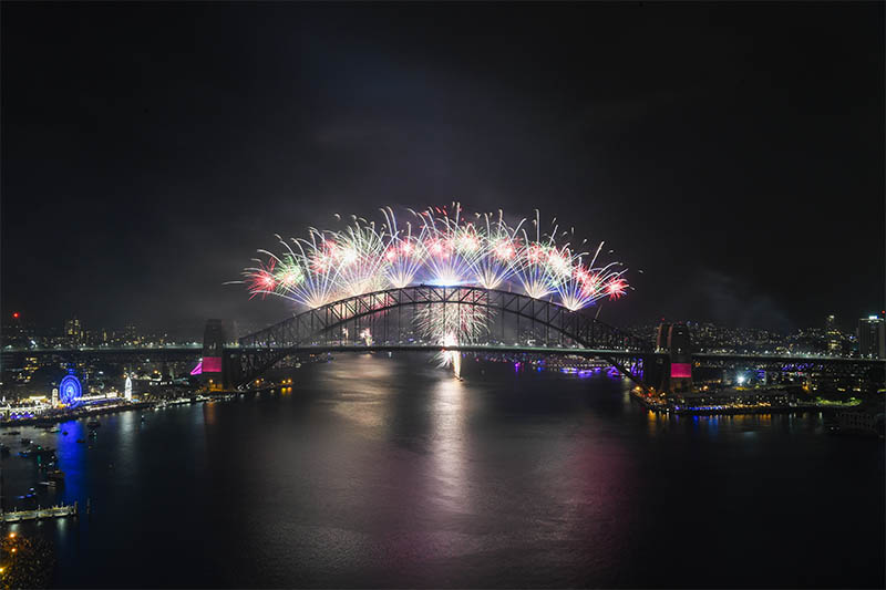 The midnight fireworks explode over the Sydney Harbour Bridge on Sydney Harbour during the Year's Eve celebrations in Sydney, Australia, December 31, 2019. Photo: Reuters