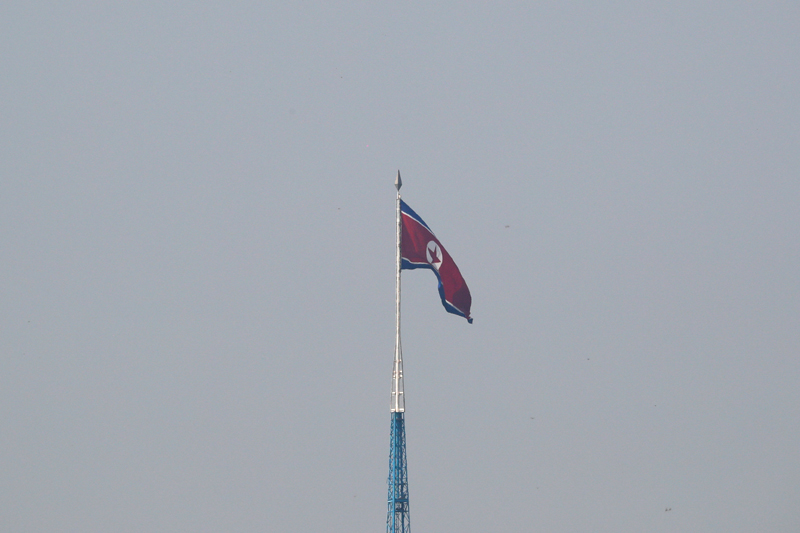 A North Korean flag flutters on top of the 160-metre tall tower at North Korea's propaganda village of Gijungdong, in this picture taken from Tae Sung freedom village near the Military Demarcation Line (MDL), inside the demilitarised zone separating the two Koreas, in Paju, South Korea, September 30, 2019. Photo: Reuters/File