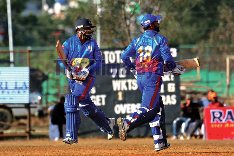 Kushal Bhurtel (left) and Ravi Inder Singh of Pokhara Paltan running between the wickets during their Namaste Pokhara Premier League match against Kathmandu Golden Warriors at the Pokhara Stadium in Kaski on Sunday, December 15, 2019. Photo: Udipt Singh Chhetry / THT